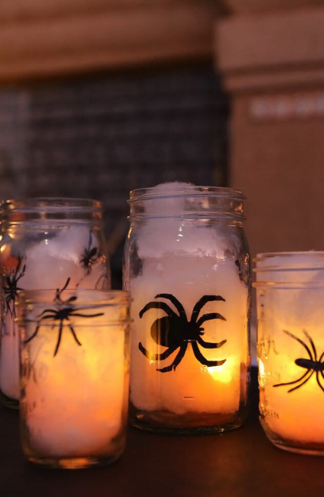 Mason jars are great for spider web lights. Here are 20 spellbinding fall mason jar crafts DIY ideas!