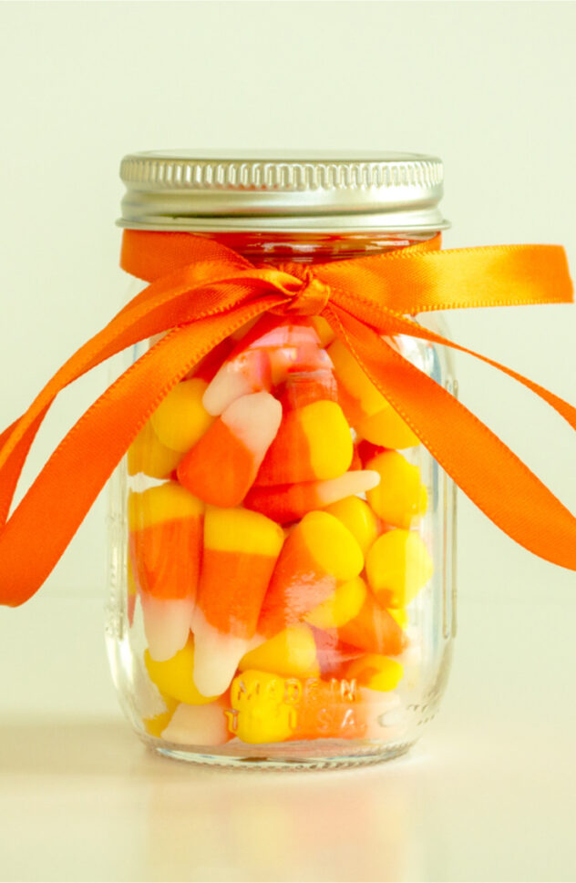 Candy corn mason jars are the perfect gift for your friends this fall! Here are 20 spellbinding fall mason jar crafts DIY ideas!
