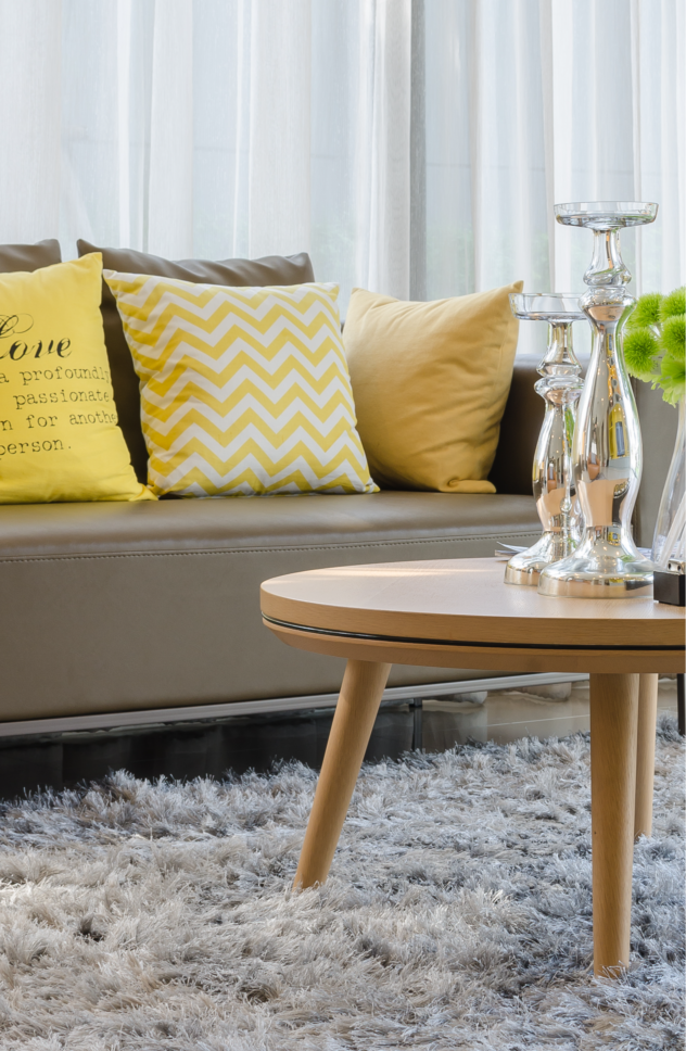 Home upgrades on a budget are possible! Consider using oversized pillows to add a more plush look to your living room.