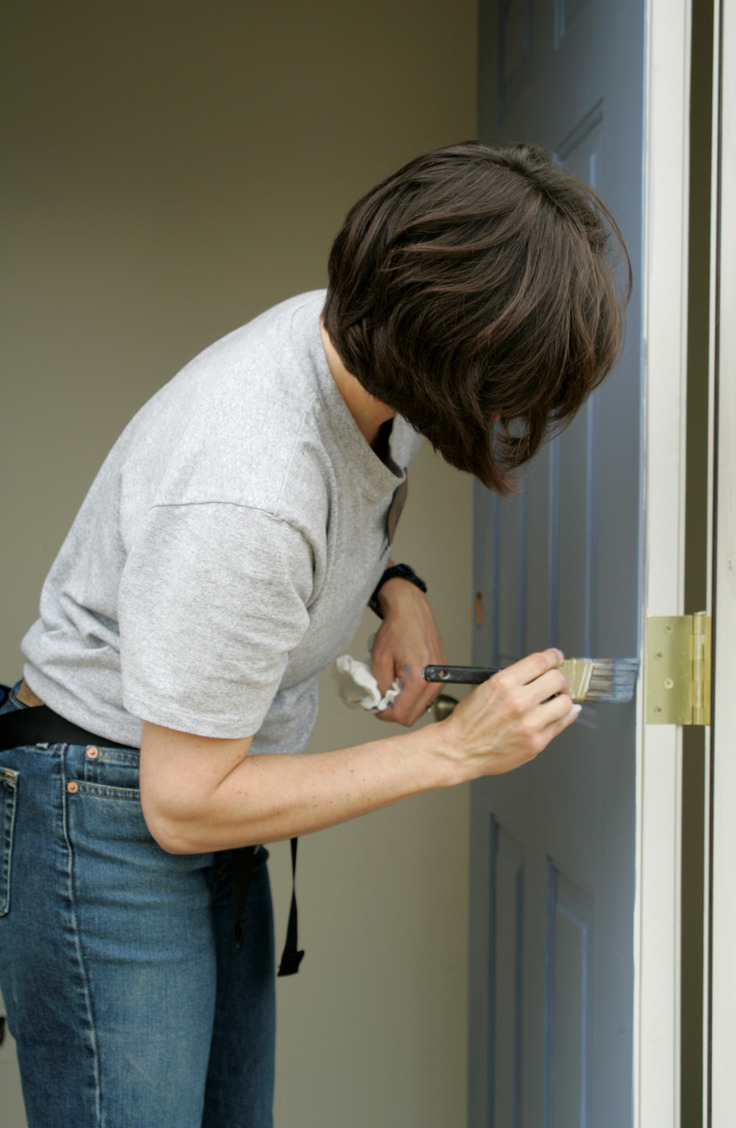 Home upgrades on a budget are possible! Giving your door a fresh coat of paint will do wonders for your home.