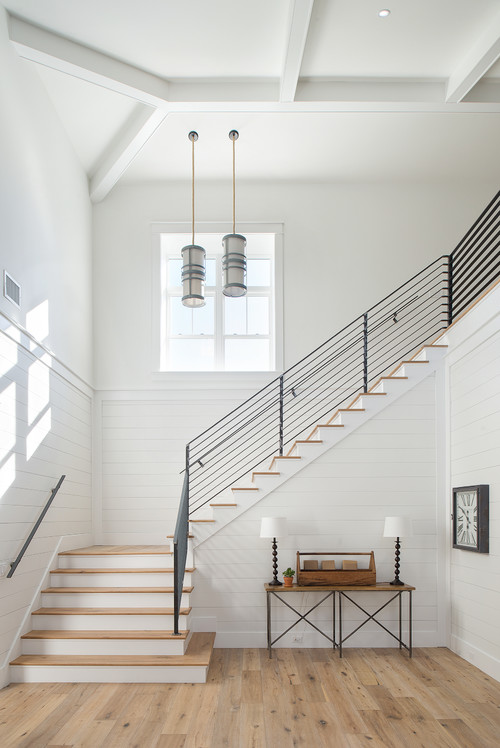 Modern Farmhouse Staircase Surrounded with Shiplap