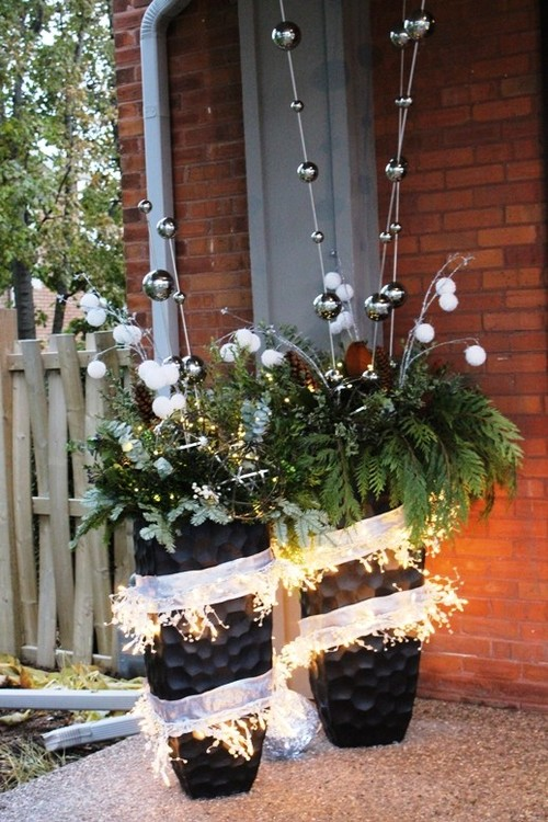 As you decorate your home this season, don't forget to include winter porch outdoor Christmas planters. Lights are amazing, but any of these outdoor Christmas planters will put the finishing touch on your winter porch decor. Don't miss them!