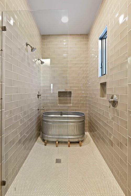 Farmhouse Style Galvanized Metal Decor Ideas: Farmhouse Bathroom with Tiled Shower and Galvanized Trough Bathtub