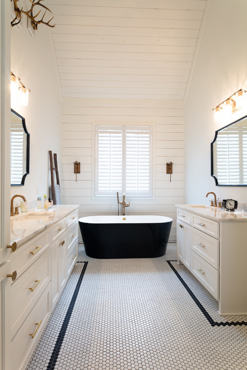 Modern Farmhouse Bathroom Decorating Ideas with Vaulted Shiplap Ceiling and Accent Wall, Black Freestanding Tub, Double Vanities with Black Trimmed Vintage Style Mirrors, and White and Black Hex Tiles for a Vintage Vibe