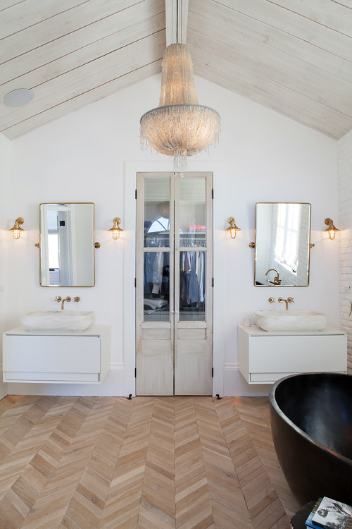 Modern Farmhouse Bathroom Decorating Ideas with a Planked Ceiling, Vintage Style European Chandelier, Double Vanities, Vintage Style Wall Sconces, a Double Glass Door Closet, and Herringbone Flooring