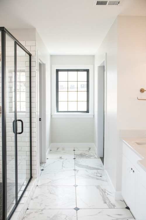 Modern Farmhouse Bathroom Decorating Ideas with White Walls, Black Window Trim, Glass Shower Door with Black Trim, Subway Tile in the Shower Stall, and White Floor Tile with a Marbled Pattern