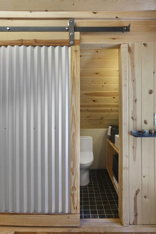 Farmhouse Style Galvanized Metal Decor Ideas: Bathroom with Farmhouse Style Corrugated Metal and Wood Sliding Barn Door