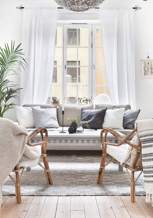 Cozy Scandinavian Living Room with Comfy Throws and and Pillows