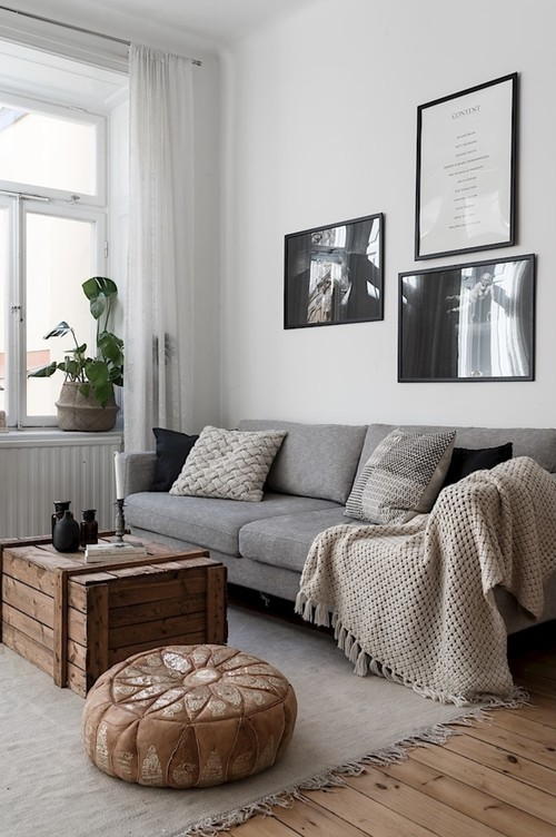 Cozy Scandinavian Living Room with Gray Couch, Beige Throw and Plush Pillows