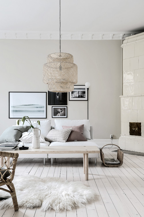 Cozy Scandinavian Living Room with White Faux Fur Rug and Couch with Throw Pillows