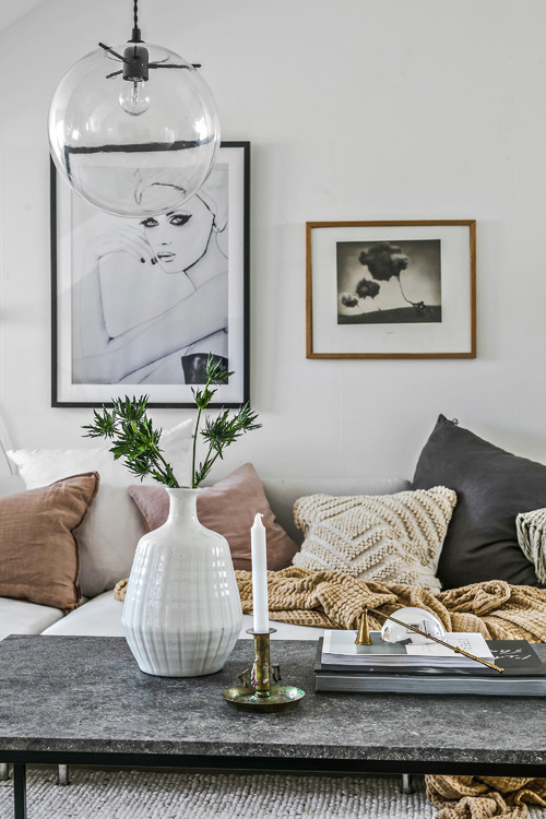 Cozy Scandinavian Living Room Couch with Knit Throw and Pillows