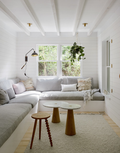 Cozy Scandinavian Living Room with Built-in Sectional Couch and Throw Pillows
