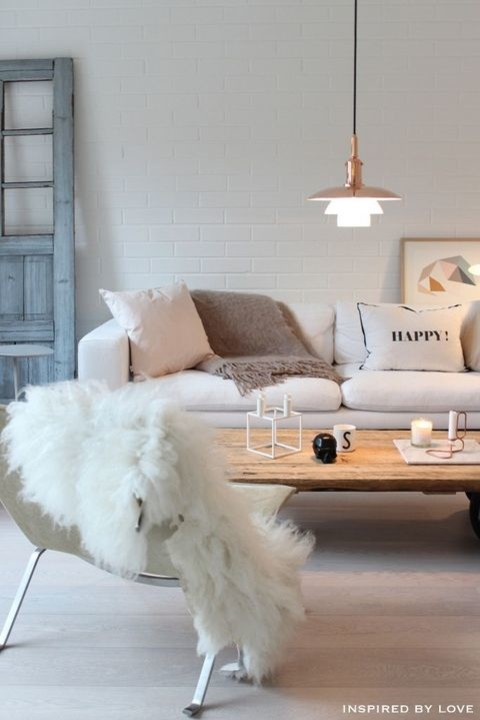 Cozy Scandinavian Living Room with White Faux Fur Throw and White Couch with Throw Pillows