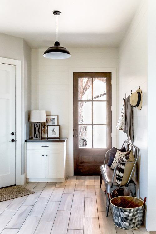 Modern Farmhouse Entry with Metal Bench and Wall Hooks #modernfarmhouse