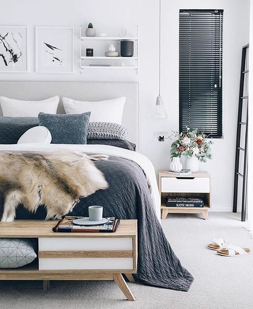 Modern Scandinavian Farmhouse Style Bedroom with Cozy Slate Blue Bedding and a Faux Fur Throw