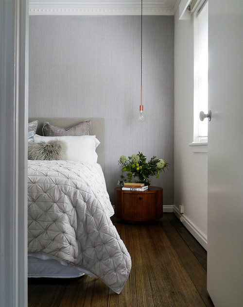 Modern Scandinavian Farmhouse Style Bedroom with Light Gray Pleated Comforter and Faux Fur Pillow