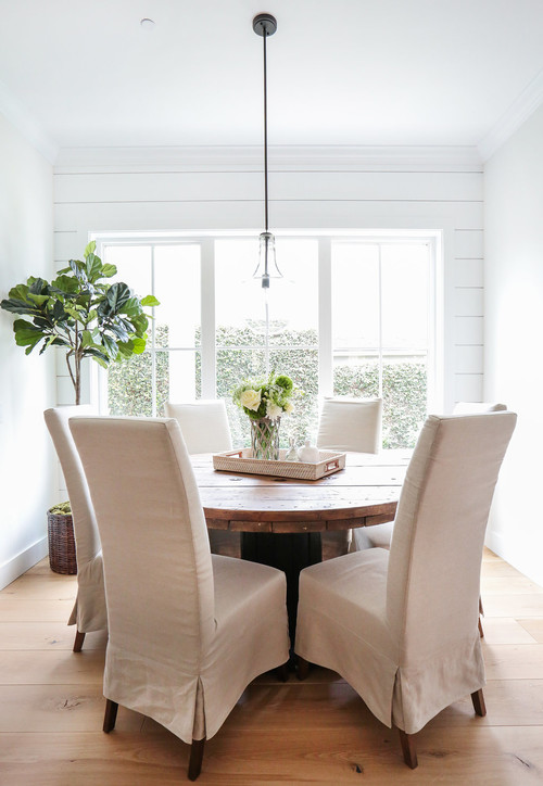 Modern Farmhouse Breakfast Nook with Round Table and Windows