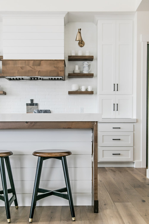 Closeup of White and Wood Modern Farmhouse Kitchen with White Cabinets and Wood Trimmed Island