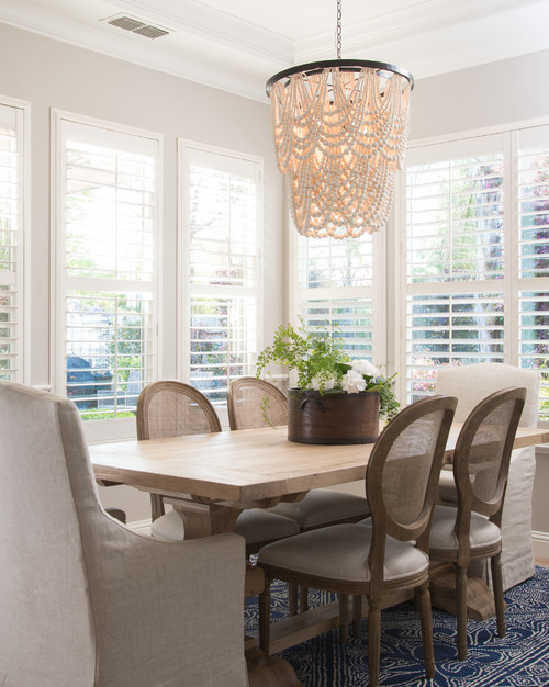 Modern Farmhouse Dining Room with Farmhouse Double Pedestal Trestle Table and Oval Back Dining Chairs