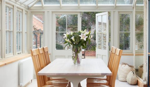 Modern Farmhouse Dining Room with Farmhouse Double Pedestal Trestle Table and Wooden Chairs
