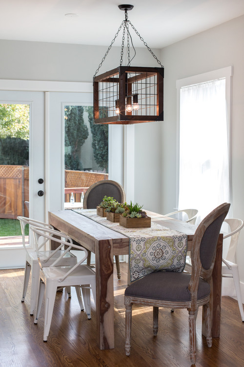Modern Farmhouse Dining Room with Farmhouse Table, Metal Chairs and Oval Back Chairs
