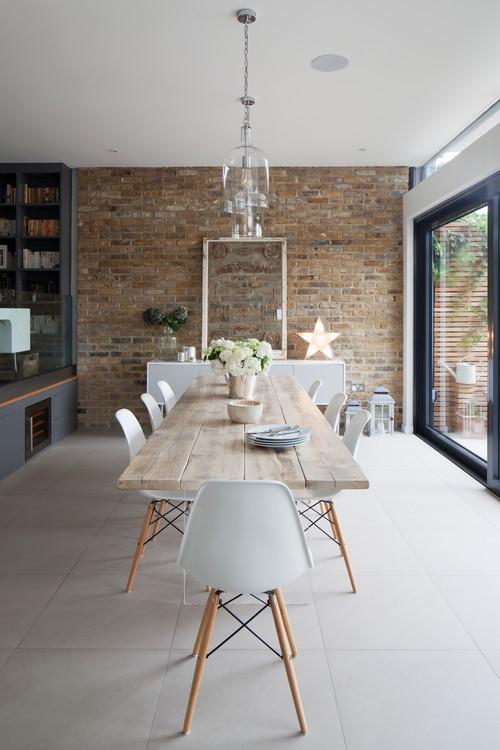 Modern Farmhouse Dining Room with Farmhouse Table and Brick Wall