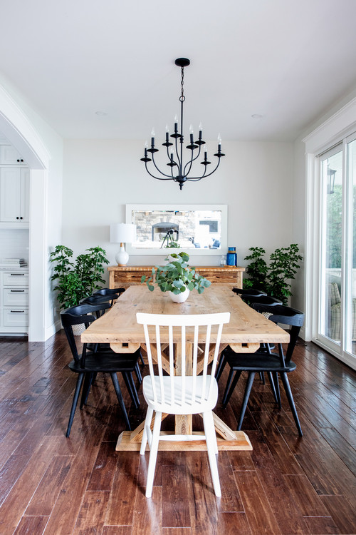 Modern Farmhouse Dining Room with Farmhouse Trestle Table and Black Wooden Dining Chairs