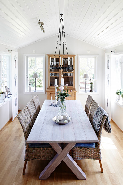 Modern Farmhouse Dining Room with Whitewashed Farmhouse X-Base Table and Wicker Chairs