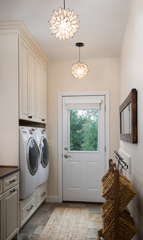 Modern Farmhouse Laundry Room with Elegant Lighting