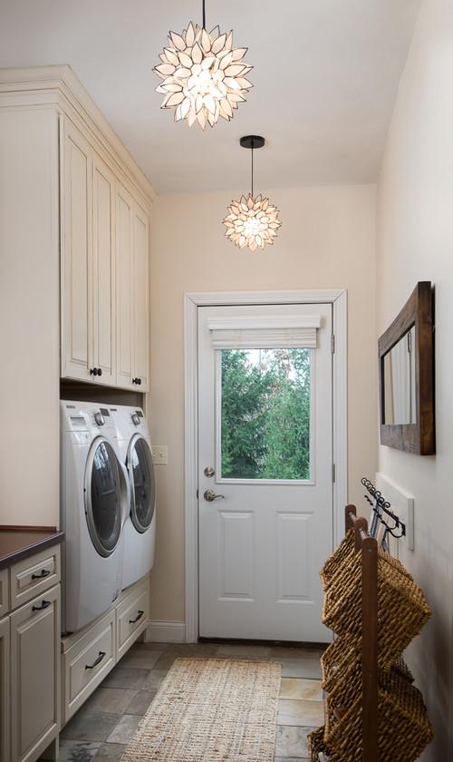 Modern Farmhouse Laundry Room with Elegant Lighting