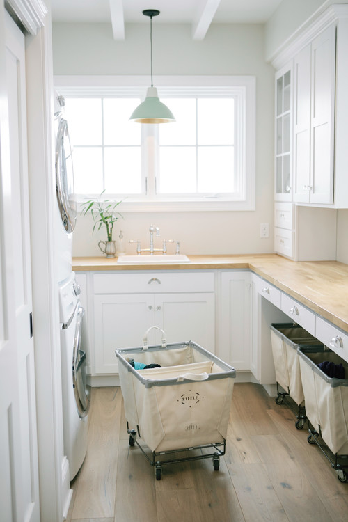 Modern Farmhouse Laundry Room with Rolling Bins