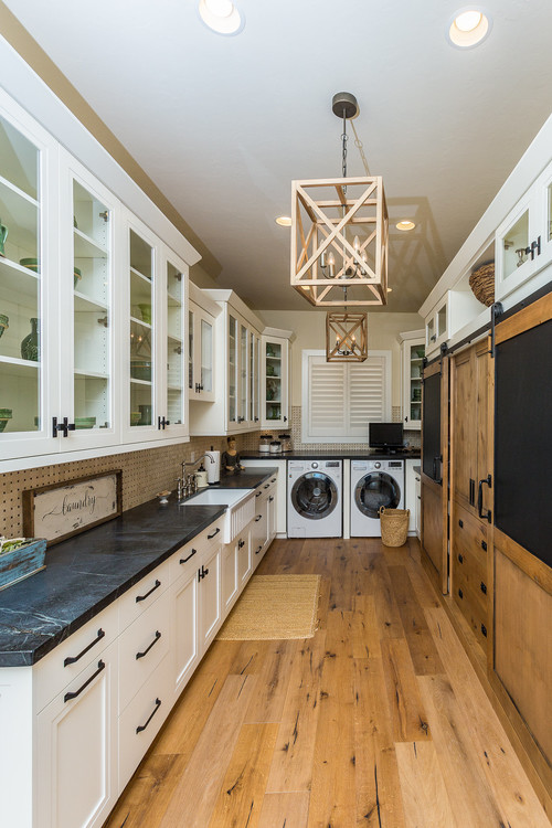 Modern Farmhouse Laundry Room with Wood Floor and Wood Sliding Barn Door