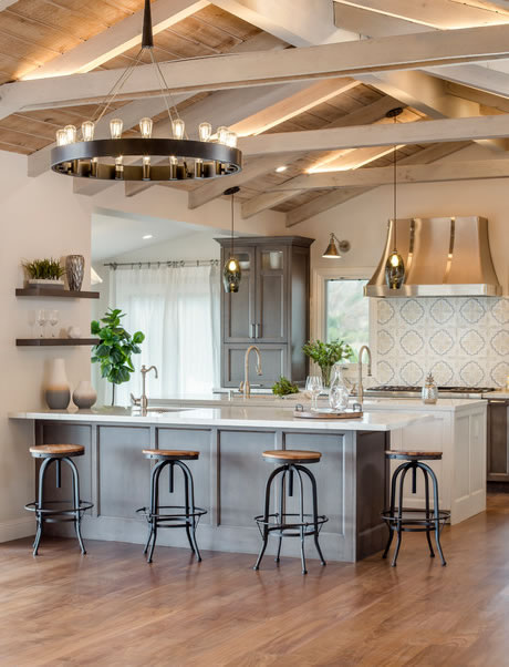 Neutral Modern Farmhouse Kitchen with Gray Kitchen Island and Elegant Lighting