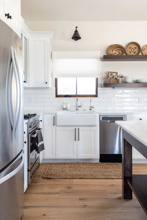 White and Wood Modern Farmhouse Kitchen with White Cabinets, Floating Wood Open Shelves and Hardwood Floor
