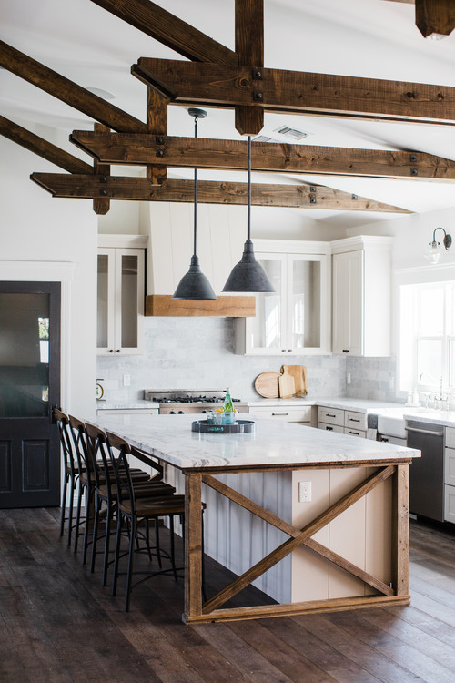 White and Wood Modern Farmhouse Kitchen with White Cabinets, Wood X on the Island and Wood Beams