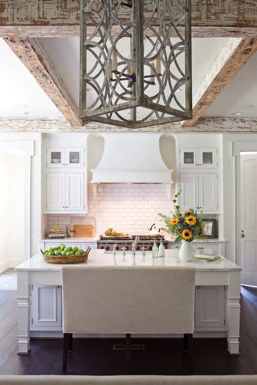 White and Wood Modern Farmhouse Kitchen with White Cabinets and Distressed Wood Beams