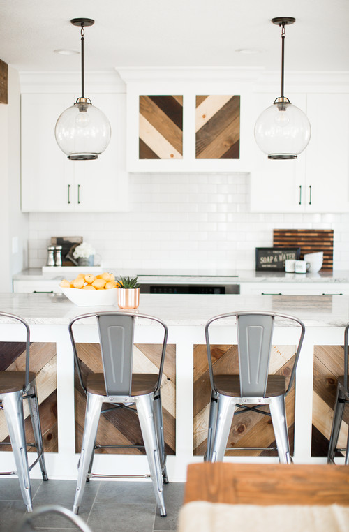 White and Wood Modern Farmhouse Kitchen with White Cabinets and Reclaimed Wood Island