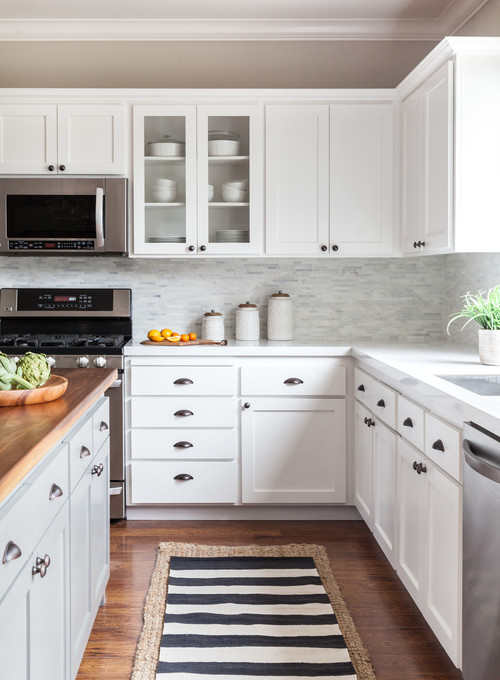 White and Wood Modern Farmhouse Kitchen with White Cabinets and Wood Island Countertop