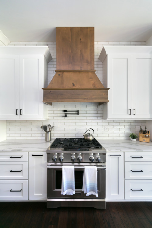 White and Wood Modern Farmhouse Kitchen with White Cabinets and Wood Range Hood