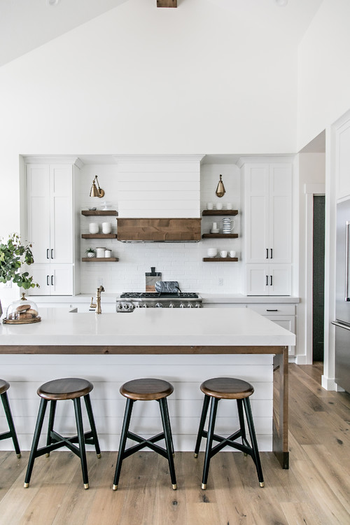 White and Wood Modern Farmhouse Kitchen with White Cabinets and Wood Trimmed Island