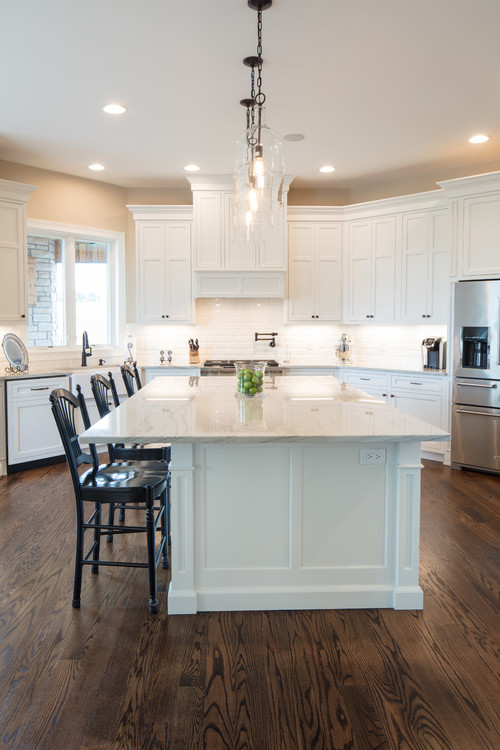 White and Wood Modern Farmhouse Kitchen with White Inset Cabinets and Hardwood Floors