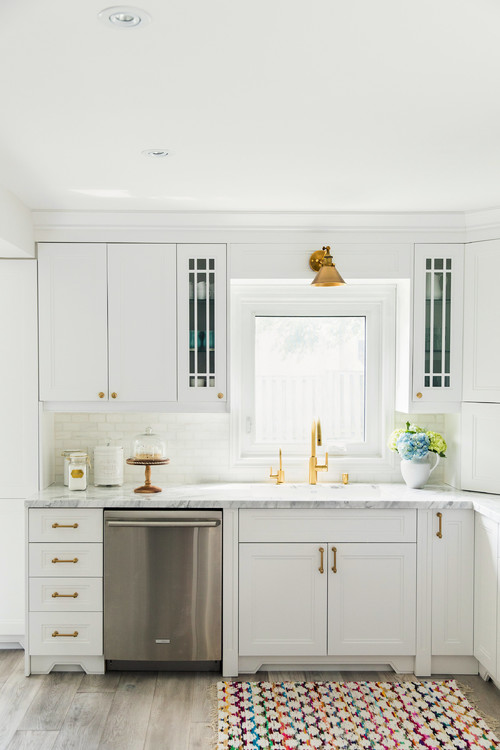 Farmhouse Fresh Kitchen Sink Flanked by Glass Upper Cabinets