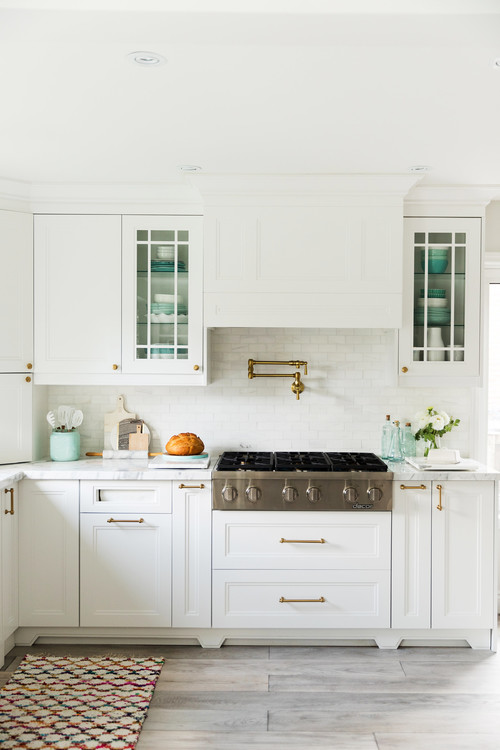 Farmhouse Fresh Kitchen Stove Flanked by Glass Upper Cabinets