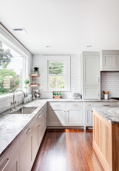 Farmhouse Fresh Kitchen with Light Gray Cabinetry and White Subway Tile Backsplash