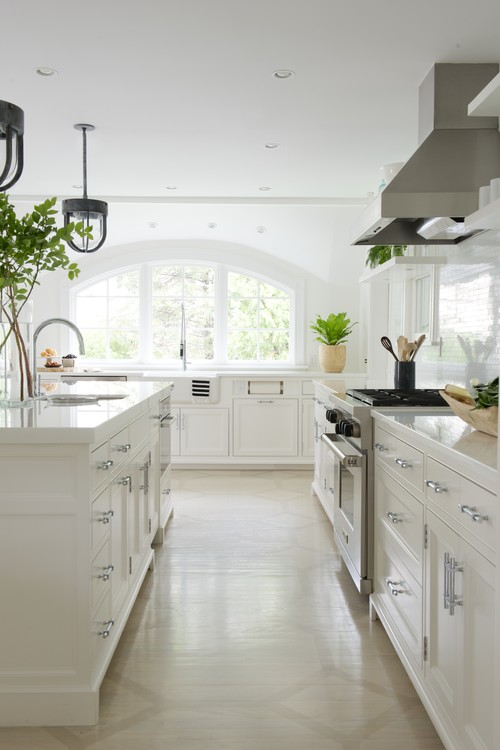 Farmhouse Fresh Kitchen with White Cabinetry and Arched Window