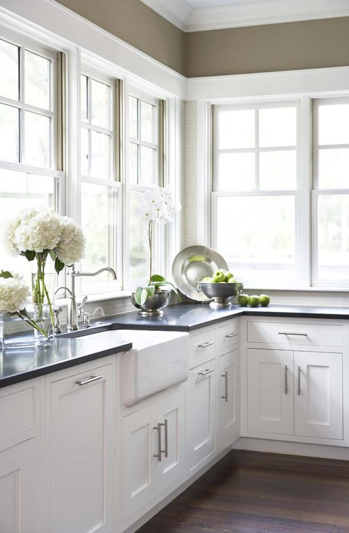 Farmhouse Fresh Kitchen with White Cabinetry and Plenty of Windows