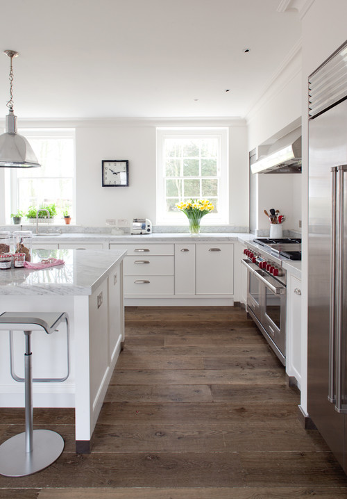 Farmhouse Fresh Kitchen with White Cabinetry and Wide-plank Wood Floor