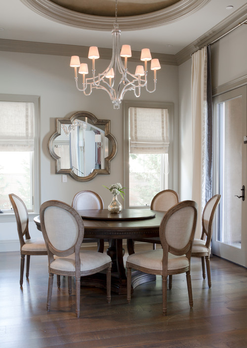 Modern Farmhouse Dining Room with Dark Wooden Table and Wooden Round Back Dining Chairs