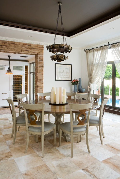 Modern Farmhouse Dining Room with Round Wooden Table and Unique Dining Chairs