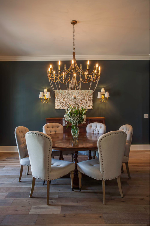Modern Farmhouse Dining Room with Round Wooden Table and Upholstered Nailhead Dining Chairs